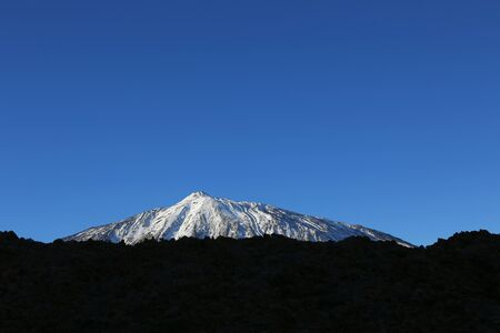 tableland: Snow-capped peak of Mount Teide, Tenerife, Canary Islands Stock Photo