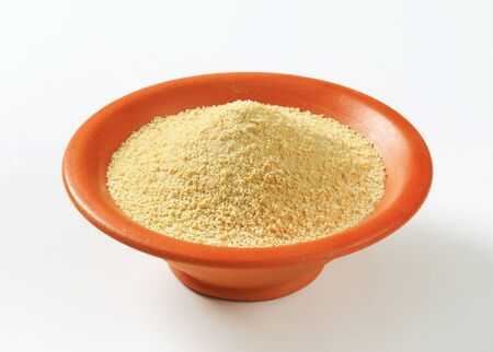 Bowl of dry bread crumbs Stock Photo