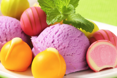 ganache: Fruit-flavored ice cream and white chocolate bonbons with fruit ganache filling
