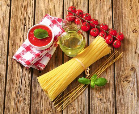 tomato puree: Still life of dried spaghetti, tomato puree and olive oil Stock Photo