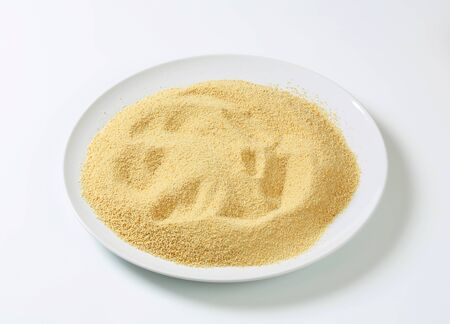 breadcrumbs: Dry bread crumbs on plate Stock Photo