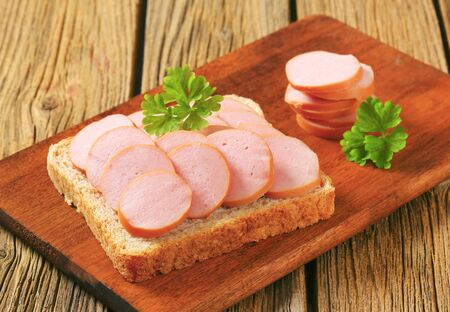 whole wheat bread: Whole wheat bread with slices of lean sausage