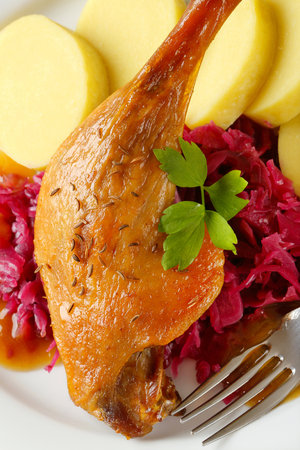 red braised: Dish of roast duck leg with potato dumplings and braised red cabbage Stock Photo