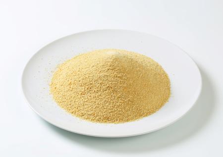 crumbing: Dry bread crumbs on plate Stock Photo