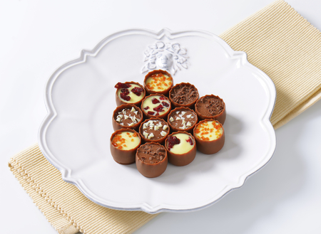 centres: Delicate milk chocolate cups with liqueur and ganache centres