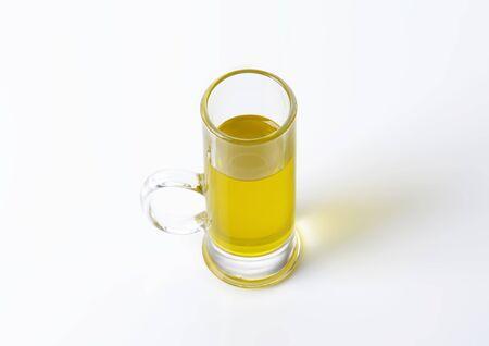tall glass: Olive oil in tall glass mug