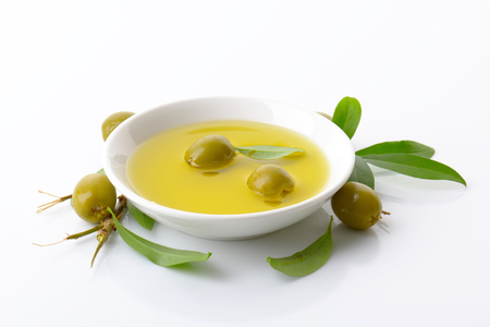 green olives: Pitted green olives and bowl of oil