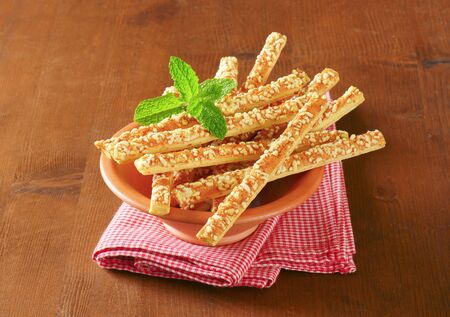 breadstick: Puff-pastry strips with cheese topping Stock Photo