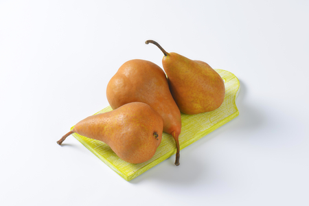 elongated: European pears with elongated slender neck and russeted skin