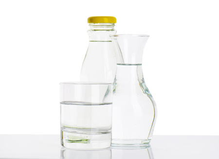 carafe: bottle, carafe and glass of fresh water Stock Photo