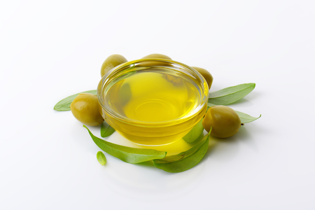 glass bowl: Olive oil in glass bowl Stock Photo