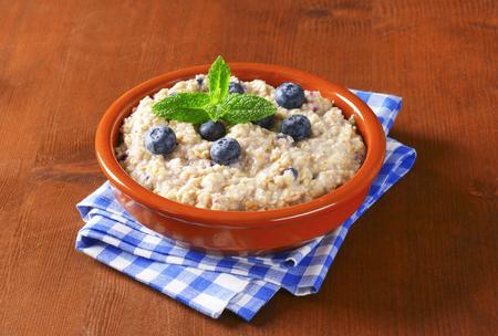 whole grain: Bowl of whole grain oat porridge with blueberries