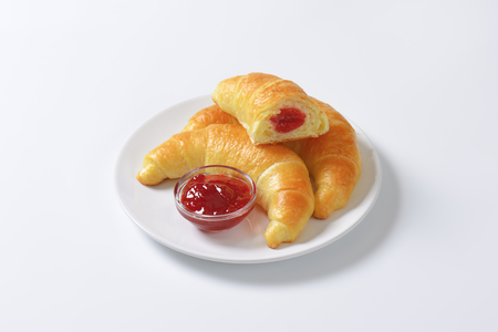 filled: Crisp crescent rolls filled with jam Stock Photo