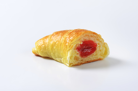 filled roll: Crisp crescent roll filled with jam Stock Photo