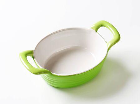 bakeware: Empty green ceramic baking dish