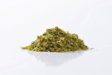 origanum: Heap of dried Marjoram leaves Stock Photo