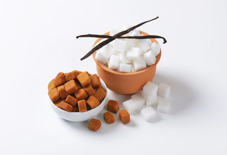 sugar cubes: Bowls of white and brown sugar cubes Stock Photo