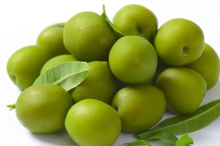 green olives: Fresh green olives on white background