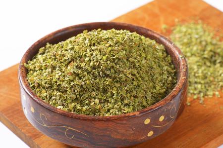 marjoram: Heap of dried Marjoram leaves in a wooden bowl