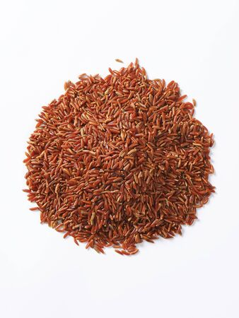 organically: Heap of Camargue red rice (Grown organically in the wetlands of Southern France) Stock Photo