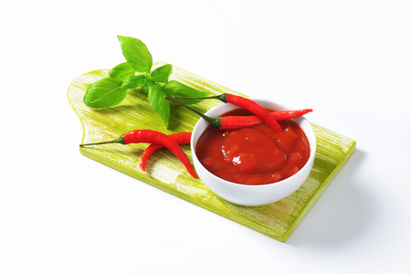 hot peppers: Tomato sauce with hot peppers, garlic and onion Stock Photo