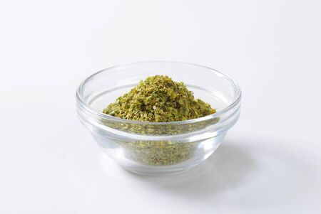 origanum: Bowl of dried Marjoram leaves Stock Photo