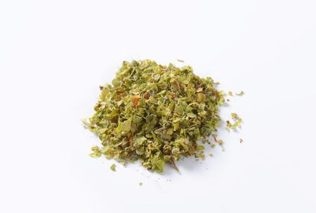 marjoram: Heap of dried Marjoram leaves Stock Photo
