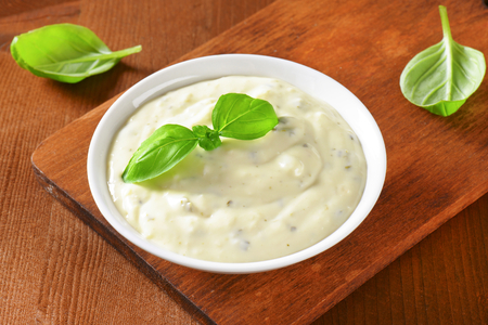 Creamy salad dressing made of mayonnaise, buttermilk, garlic, herbs, spices and grated cheese
