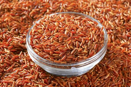 organically: Grains of Camargue red rice (Grown organically in the wetlands of Southern France)