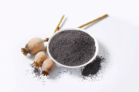 Whole poppy seeds on plate