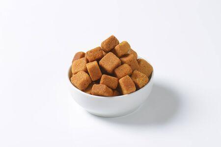 cane sugar: Pure cane sugar, brown rough cut cubes Stock Photo