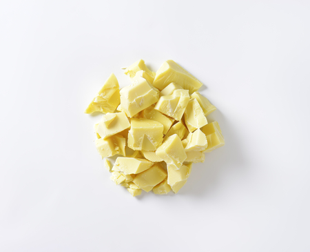 indulgence: Pieces of white chocolate - studio shot