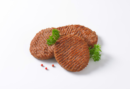mincing: Three Grilled Beef Burger Patties