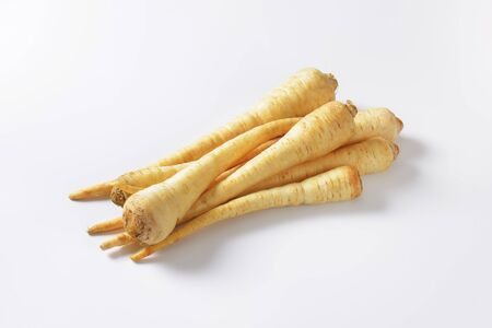 long shots: parsley roots on white background Stock Photo
