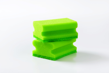 scouring: two green kitchen sponges with scouring pad Stock Photo