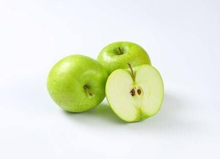 two and a half: Two whole and half a green apple