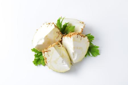 apium graveolens: fresh celery root cut into quarters Stock Photo