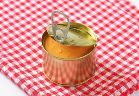 canned: canned pate on checkered tablecloth