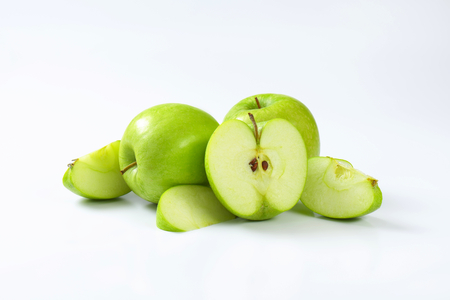 green apples: Whole and cut green apples Stock Photo