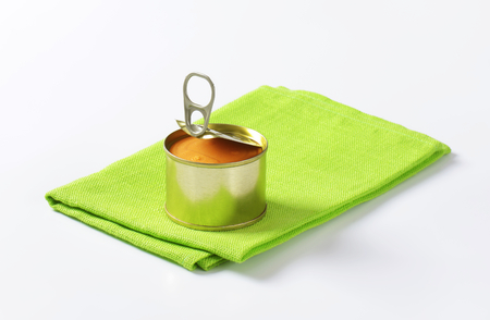 unlabelled: canned pate on folded green cloth
