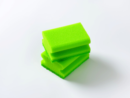 two green kitchen sponges with scouring pad Banco de Imagens