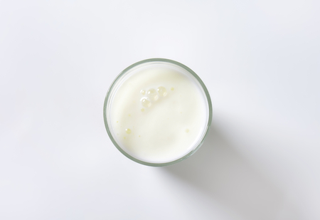 drinking milk: glass of milk on white background Stock Photo