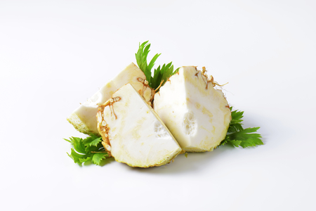 apium graveolens: fresh celery root cut into quarters Stock Photo