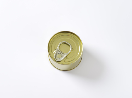 gold cans: tin can on white background