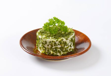 coated: fresh cheese coated in chives and garlic