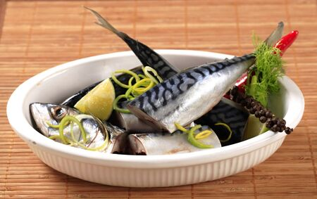 casserole dish: Pieces of raw mackerel in a casserole dish