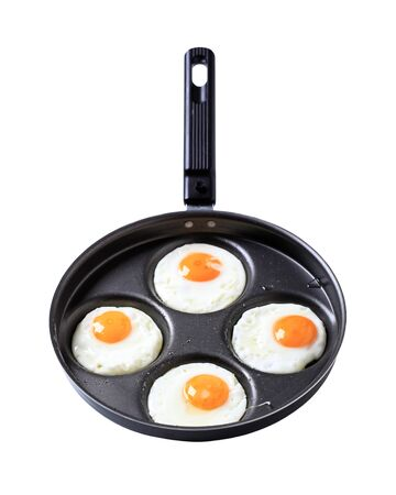 frying pan: Four fried eggs on frying pan Stock Photo