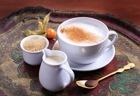 nutmeg: Cup of milk streamer with nutmeg and  brown sugar Stock Photo