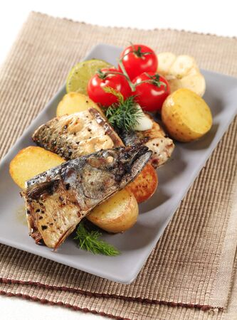 pan fried: Pan fried mackerel served with roasted potatoes Stock Photo