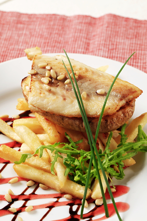 pan fried: Pan fried fish fillet with baked potato and French fries Stock Photo
